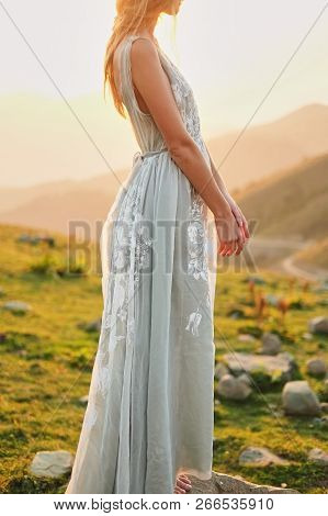 Fine-art Wedding. Beautiful Girl With Gorgeous Slim In Gray Dress With Hand-painted Flowers Stands A