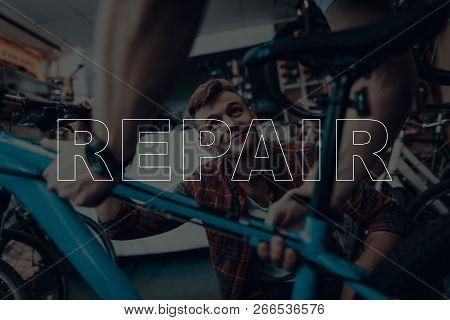 Bicycle Shop. Bicycle Repair. Customer Showing A Bicycle. Customer Bicycle Is Broken. Salesman Holdi