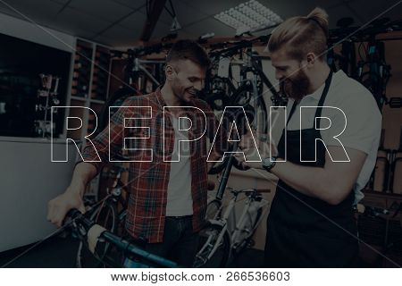 Bicycle Shop. Bicycle Repair. Salesman Showing A New Bicycle Saddle. Customer Looking On Bicycle Sad
