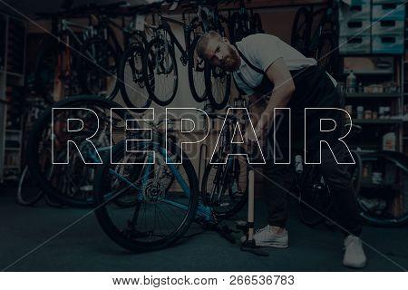 Bicycle Shop. Bicycle Repair. Salesman Using A Bicycle. Salesman Boosts The Wheel. Salesman Using Pu