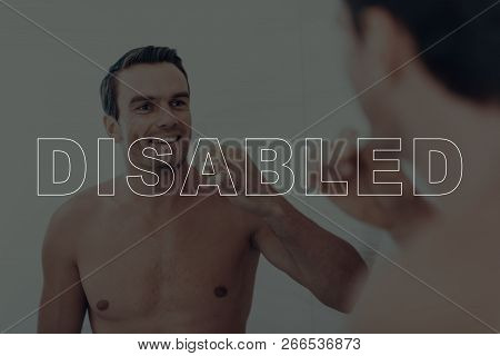 Disabled Man. Man Looking At Himself In The Mirror. Man Is Happy And Smiling. Man Is Brushing Her Te