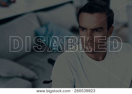 Disabled Man In A Wheelchair. Man Looks Into Distance. Man Is Serious. Man Is Thinking. Adult Brunet