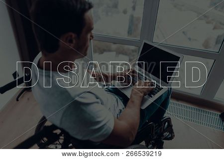 Disabled Man In A Wheelchair. Man Sitting In Front Of Window. Large Panoramic Window. Man Using A La