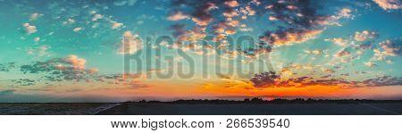 Sun Shining On Horizon During Sunset Sunrise. Panorama Of Sea Ocean Coast. Natural Sky Warm Colors.