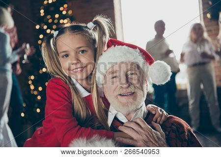 Close-up Portrait Of Joyful Girl Hugging Grandpa In Headwear. Noel Gathering, Full Family Custom. Gr