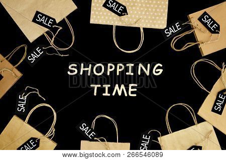 Craft Paper Shopping Bag On Black Isolated Background With Wooden Text