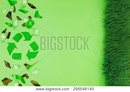 Green Recycle Sign Symbol With Shattered Glass Trash Garbage Bottle, Pills On Green Isolated Backgro