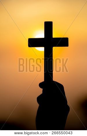 Silhouette Off Woman Hands Holding Wooden Cross On Sunrise Background, Crucifix, Symbol Of Faith.