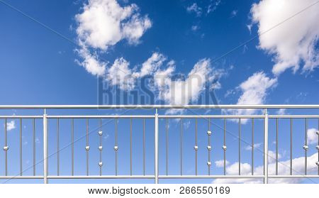 Chrome, Stainless Steel , Inox  Or Alu Fence. Aluminum Fence With Clouds Sky Background. 3d Illustra