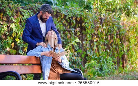 Romantic Relations Concept. Couple In Love Romantic Date Nature Park Background. Girl Sit Bench Read