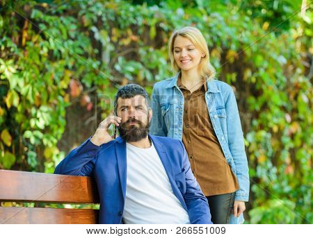 Romantic Concept. Couple In Love Romantic Date Walk Nature Park Background. Man Bearded Hipster Wait