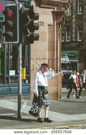 Edinburgh, Scotland - May 18: Scotsman In Traditional Scottish Cloth - Kilt In Centre Of City On May