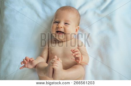 Adorable Smile. Happy Newborn Baby. Newborn Baby Care. Pediatric Care For Happy Baby. Caring For Fut