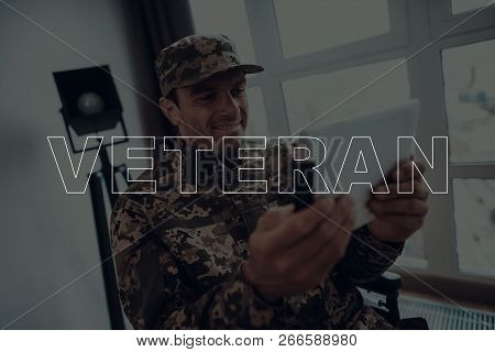 Military Veteran. Disabled Man In A Wheelchair. Man Sits In Front Of Window. Man Is Soldier. Soldier