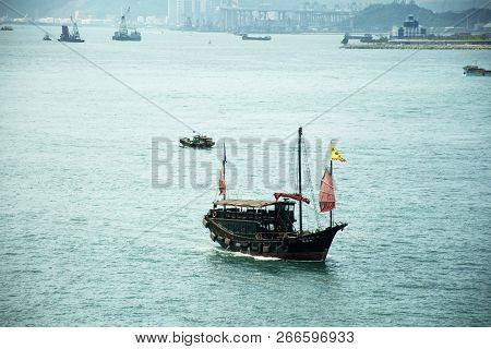 Retro Wooden Ship Or Chinese Junk Boats For Travelers People Looking View Of Hong Kong And Kowloon I