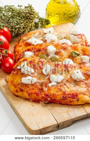 Tris Of Mixed Pizza On Wood With Ingredients