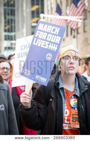 March For Our Lives: A woman holds a sign that says March For Our Lives during the march to end gun violence on 6th Ave, NEW YORK MAR 24 2018.