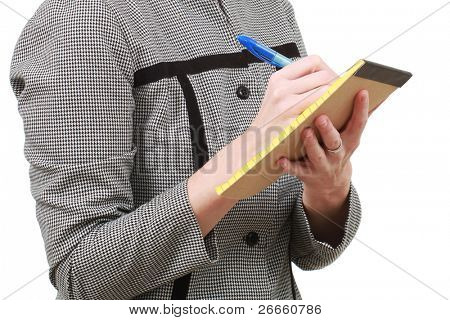 Older woman writing on a small notepad