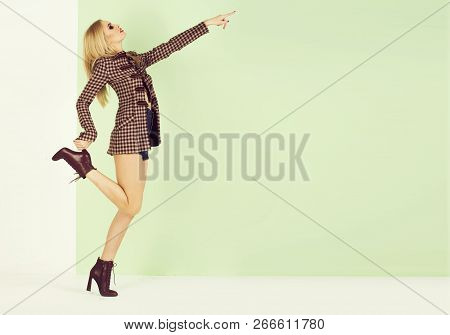 Fashion. Sensual Glamour Beautiful Woman Model With Makeup Has Red Lips In Fashionable Coat Or Jacke