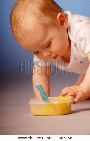 Baby Playing With A Food