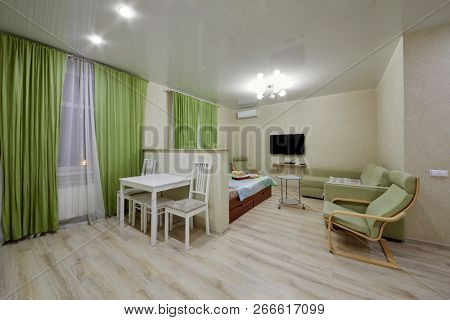 KAZAN, RUSSIA - DEC 7, 2017: Modern room divided into zones in hotel Apartments on Bauman. Apartments located near Kazan Kremlin and Kul Sharif Mosque.