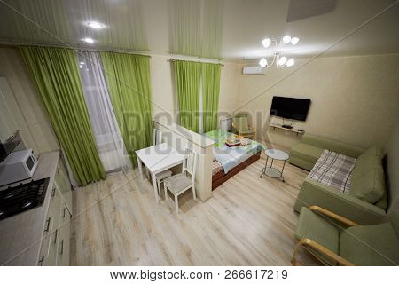 KAZAN, RUSSIA - DEC 7, 2017: Modern lodging divided into kitchen and living zones in hotel Apartments on Bauman. Apartments located near Kazan Kremlin and Kul Sharif Mosque.
