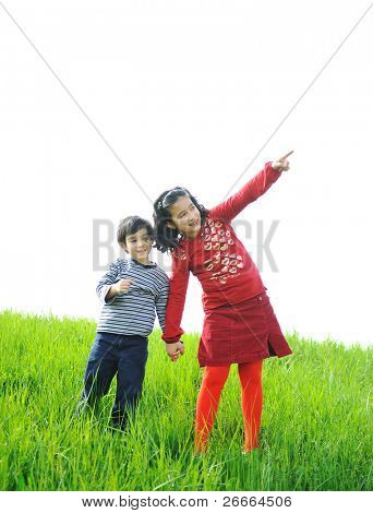 Two children play in the field