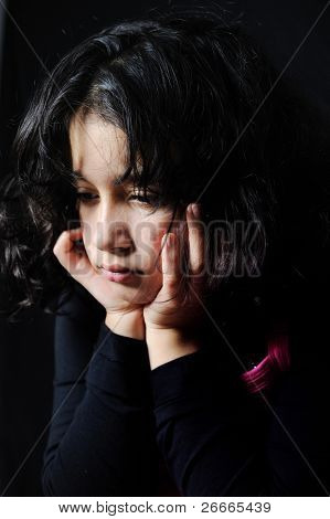 sad girl sitting in dark