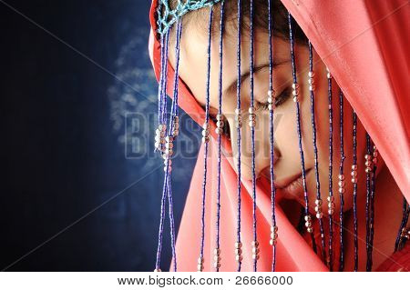 Adorable beautiful girl with veil and scarf