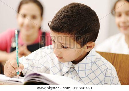 happy working successful children in the school, classroom