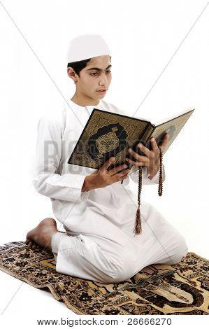 Little muslim boy with koran poster