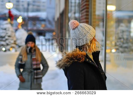 Christmas Shopping And Winter Holidays. Beautiful Woman Looking At Window Shop On Mall