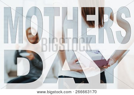 Mothers Day. Happy Family. Daughter Holding Present To Mother. Mother Drinking Tea. Mother On Backgr