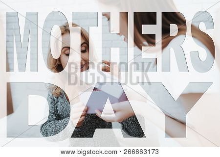 Mothers Day. Happy Family. Daughter Showing Present To Mother. Girl Opened Present. Mother And Daugh
