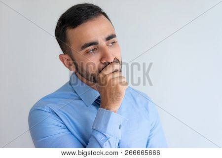 Pensive Young Bearded Man Concentrated On Thoughts Looking Into Distance. Contemplative Businessman