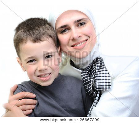 Muslim young woman with little cute boy poster
