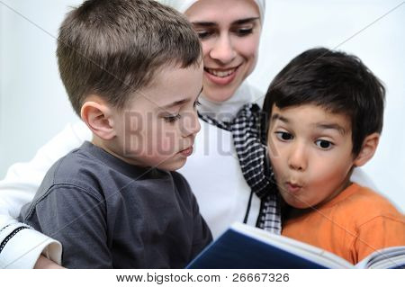 Mother and her son in the nature, reading together