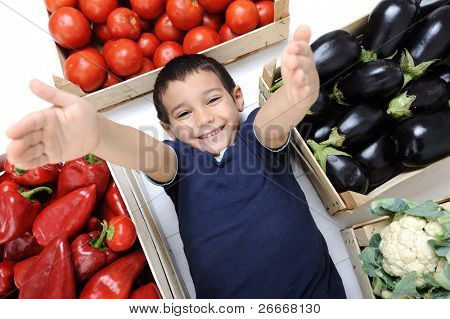 Happy kid with vegetables