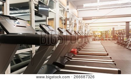 Fitness Gym Club With Row Of Treadmills For Fitness Cardio Training. Healthy Lifestyle Concept. Mode