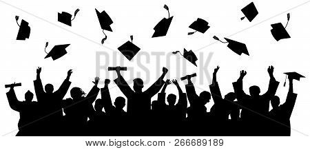 Graduated At University, College. Crowd Of Graduates In Mantles, Throws Up The Square Academic Caps.