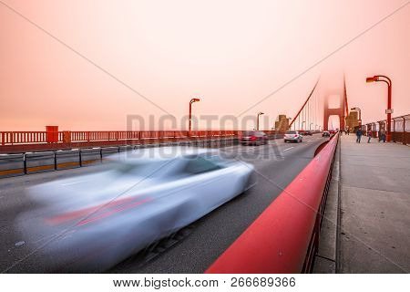Cars Crossing The San Francisco, Californian Golden Gate Bridge From The Presidio Pacific Point To T