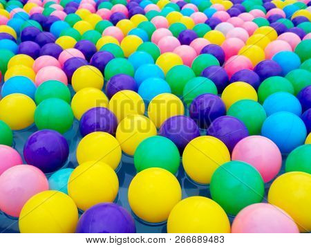 Colorful Of Balls Floating In Pool For Children In Water Park.