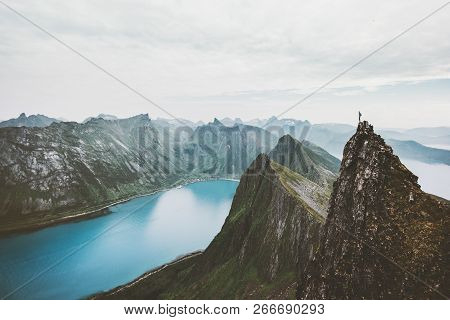 Norway Mountain Travel Man Standing On Cliff Edge Above Fjord Adventure Extreme Climbing Lifestyle J
