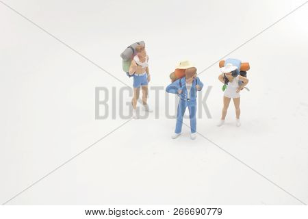 A Traveler Mini People With Backpack Stand