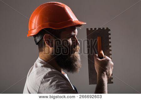 Tool, Trowel, Handyman, Man Builder. Mason Tools, Builder. Builders In Hard Hat, Helmet. Bearded Man