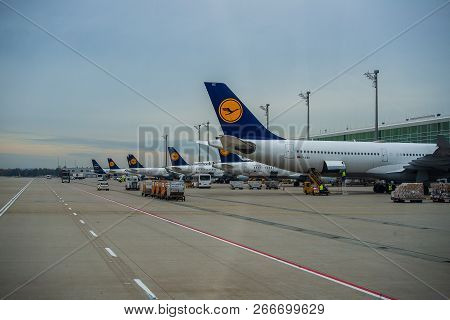 Munich,germany-november 3,2018: Lufthansa Planes Stand Outside Terminal Two At Munich Airport Betwee