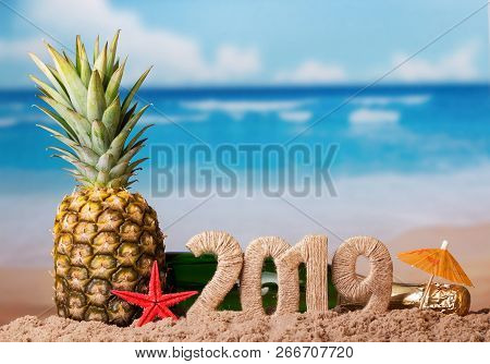 New Year Composition. Christmas Inscription 2019, Juicy Fresh Pineapple On Background Of Ocean