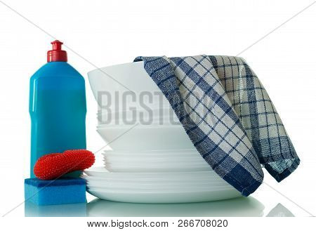 Pure White Crockery And Means For Washing Dishes, A Blue Towel Isolated On White Background