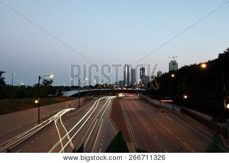 High Speed Road In The Evening Abstraction. City Road Car Light Trails Motion Background. Street Tra