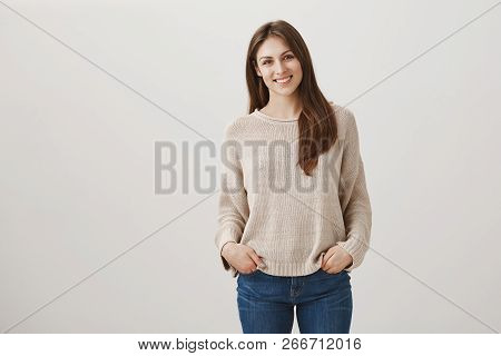 Friendly Newbie Meets With New Teammates. Indoor Shot Of Shy Attractive Female In Casual Pullover St